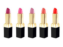 Lipstick in different colors. Lipstick in various colors on white background Royalty Free Stock Photos