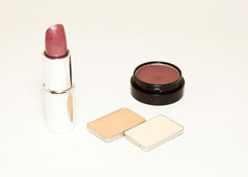 Lipstick and eye shadows Stock Photography