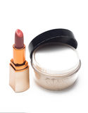 Lipstick and face powder. On a white background Royalty Free Stock Photos