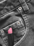 Lipstick in front pocket of pants Royalty Free Stock Image