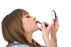 Handmirror, lipstick and girl. Royalty Free Stock Photos