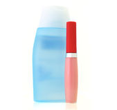 Lipstick gloss pink and Lotion Bottle Royalty Free Stock Image