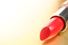 Lipstick on gold background Royalty Free Stock Images