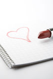 Lipstick and heart on notepad. Stock Photography