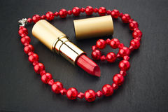 Lipstick and heart shape jewelry Royalty Free Stock Photography