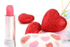 Lipstick and hearts Stock Image