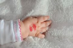 Lipstick Kiss on Babys` Arm Royalty Free Stock Image