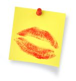 Lipstick kiss on notepaper  Stock Photography