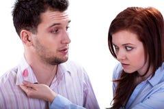 Lipstick kiss on shirt collar. Wife found a lipstick kiss on shirt collar of husband Stock Images