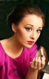 Lipstick lady. Woman applying lipstick. Close up portrait royalty free stock photo
