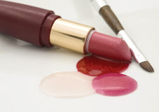 Lipstick and lip gloss Royalty Free Stock Photos