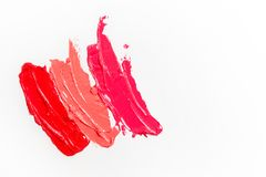 Lipstick and lip gloss, drops and strokes of different shades to create different images in makeup royalty free stock photos