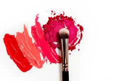 Lipstick and lip gloss, drops and strokes of different shades to create different images in makeup stock photos