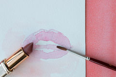 Lipstick, lips and brush. Closeup of lipstick, watercolor painted lips and a brush Royalty Free Stock Photography