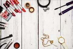 Bright face cosmetics and accessories on a light background royalty free stock images