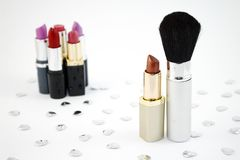 Lipstick and Make-up Brush Royalty Free Stock Photography