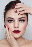 Lipstick and manicure Stock Photography