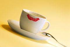 Lipstick mark on cup. Red lipstick mark on white coffee cup Stock Photo