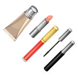 Lipstick, mascara, foundation and lip gloss Royalty Free Stock Photos