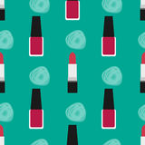 Lipstick with nail polish seamless pattern 2. Red lipstick and red nail polish at a green background with decorative spots Stock Photos