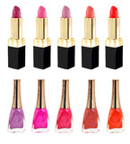 Lipstick and nailpolish in different colors. Lipstick and nail polish in various colors on white background Stock Images