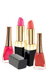Lipstick and nailpolish in two colors. Lipstick and nail polish in two colors on white background Stock Photos