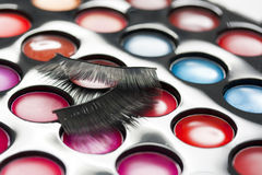 Lipstick palette and false eyelashes Royalty Free Stock Images