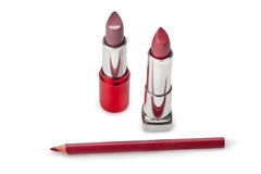 Lipstick and pencil contour Royalty Free Stock Image