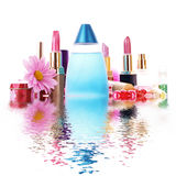 Lipstick and perfume with water Stock Photo