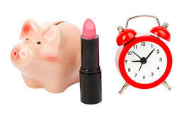Lipstick with piggy bank Stock Images