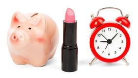 Lipstick with piggy bank on white Stock Photos