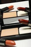 Lipstick and powder Royalty Free Stock Photos