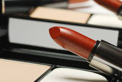 Lipstick and powder Royalty Free Stock Image