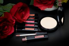 Lipstick,powder and flowers with cosmetics for women To make her Stock Photo