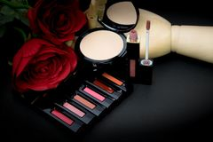 Lipstick,powder and flowers with cosmetics for women To make her Royalty Free Stock Images