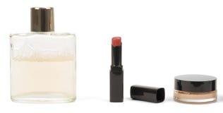 Lipstick, powder and perfume Stock Photos