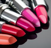 Lipstick. Professional makeup and beauty. Lipstick tints palette closeup. Colorful lipsticks Royalty Free Stock Photo