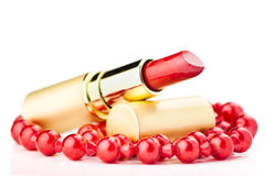Lipstick and red jewelry Stock Photo