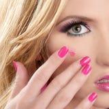 Lipstick red on makeup skin blonde macro. Closeup model pink nails Stock Photos