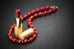 Lipstick and red  necklace Stock Images
