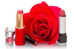 Lipstick and a red rose Royalty Free Stock Images