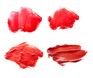 Lipstick red on a white background. Red lipstick smudged on a white isolated background Royalty Free Stock Photography