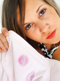 Lipstick on shirt. Woman just descovering lipstick on her husband's shirt Royalty Free Stock Image