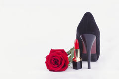 Lipstick, shoes and roses. Women's accessories on a white background Royalty Free Stock Photography