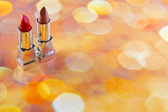 Lipstick. Two red lipsticks on a bright background Stock Image