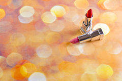 Lipstick. Two red lipsticks on a bright background Stock Photo