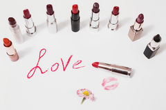 Lipstick  on white background. Female lip penci Stock Photos