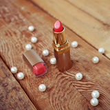 Lipstick on wooden background Stock Image