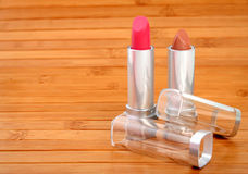 Lipstick on wooden carpet Stock Image