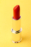 Lipstick on yellow Royalty Free Stock Photography